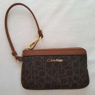 Authentic Calvin Klein corner zip wristlet brown