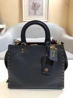 AUTHENTIC COACH ROGUE 25 WITH RIVETS SATCHEL (CO)