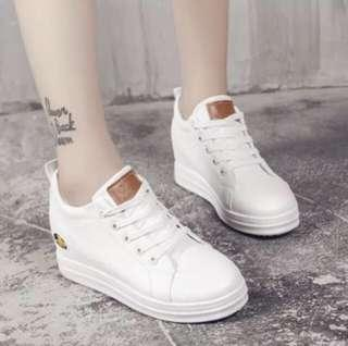 white elevated shoes