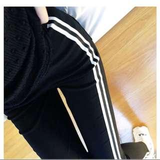 Black leggings with white stripes - Sports -