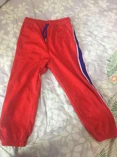 Orange quarter length pants