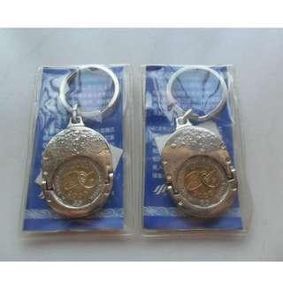 2x Singapore Mint $5-coin Keyring