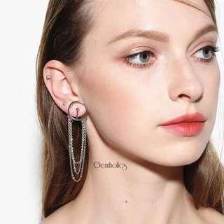 Xenia Vogue statement earring