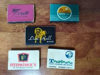5 old match boxes