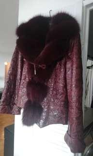 Beautiful real leather and fox fur jacket. Brand new.