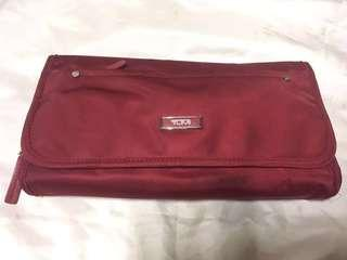 Authentic red TUMI vanity bag