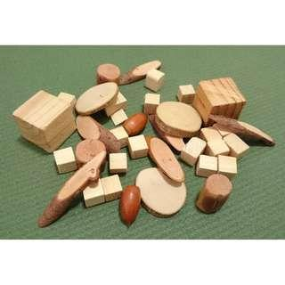 Assorted wooden blocks chips timber sections slabs pieces