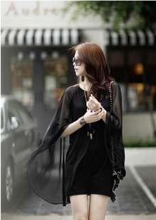 Black 'bat sleeve' dress