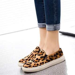 Leopard print slip-on sneakers