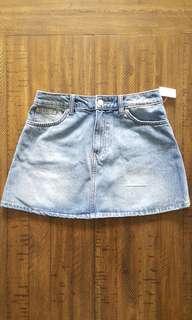 Distressed denim mini skirt *H&M*