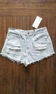 High rise mint cut-off shorts with distressed detailing *Forever 21*