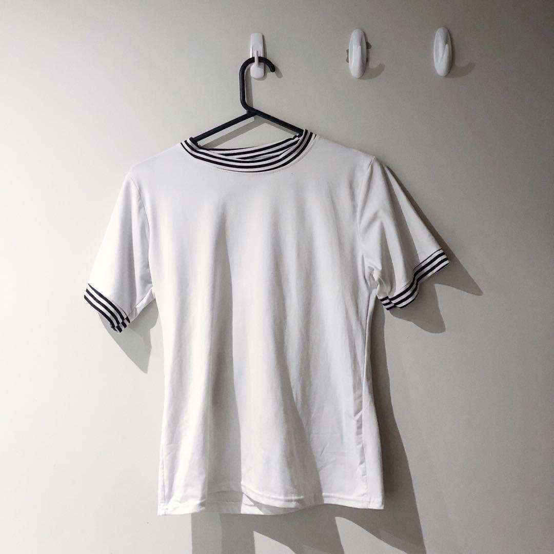 White t-shirt with stripes on the sleeve and neck
