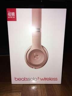 Beats rose gold wireless headphones