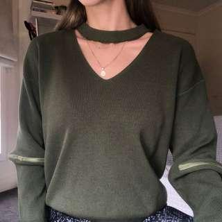 green knit jumper