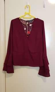Red blouse with mesh panel