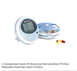Alert pill box with with alert clock