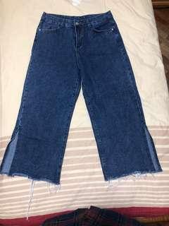 Denim pants with slits