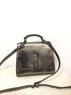 Beall metallic sling