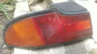 Perdana rear signal lights.