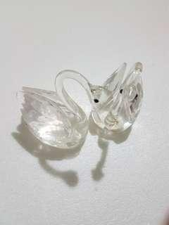 A pair of crystal swam