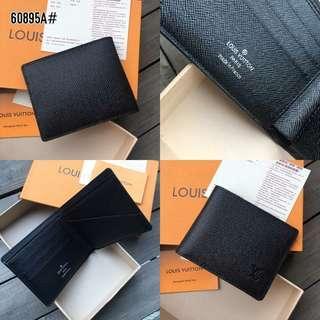 LV Louis Vuitton Taiga Leather Multiple Wallet 60895A#22   Bahan kulit (taiga leather) Dalaman taiga leather kombi smooth leather Kwalitas High Premium AAA Dompet uk 11x9cm (Uk panjang pas di buka 22cm) Berat dengan box 0,2kg  Warna Wallet  Harga 250rb