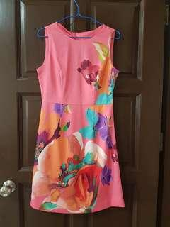 Pink sleeveless dress with artistic floral pattern