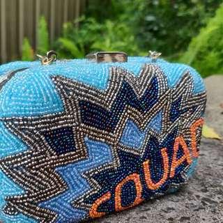 FROM ST XAVIER Squad Goals Beaded Hard Clutch