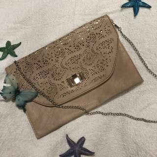 Crossroads Nude Laser Cut Sling Bag