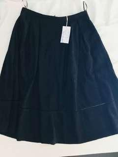 Warehouse below mid-calf A-line black skirt