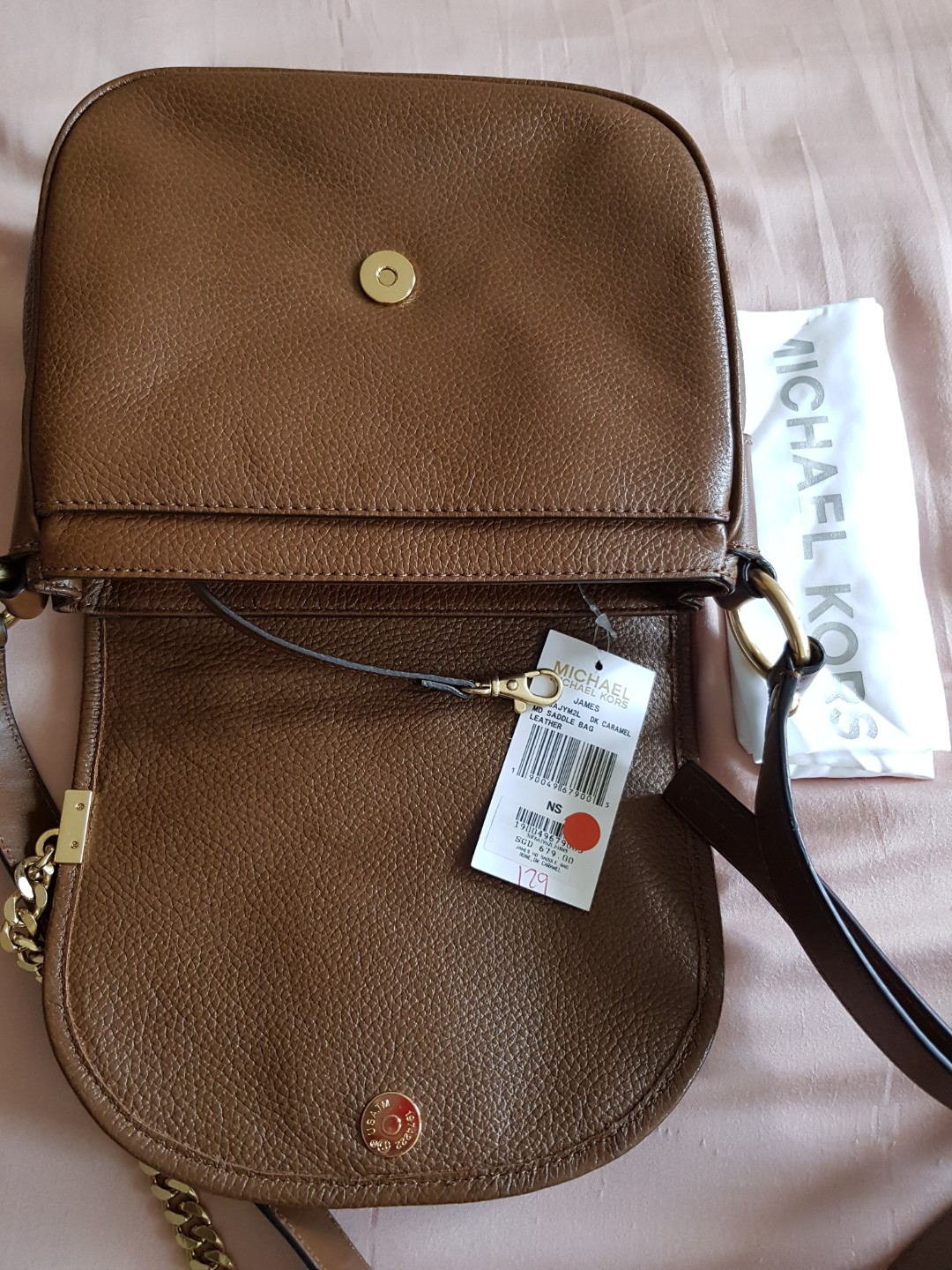 21e1bd4518098f Michael Kors MD Saddle Bag, Luxury, Bags & Wallets, Sling Bags on Carousell