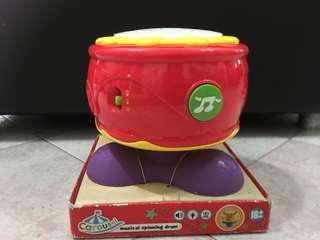Musical spinning drum