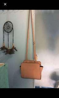 Nude pink sling bag