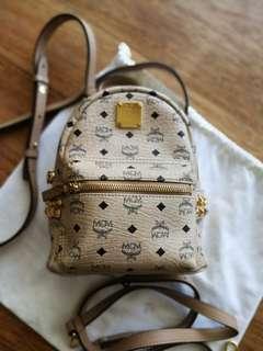 Like new MCM x mini stark backpack or sling bag