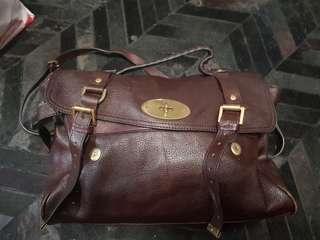 Large brown leather sling book bag.