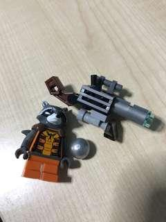 LEGO rocket raccoon orange outfit with space blaster and orb