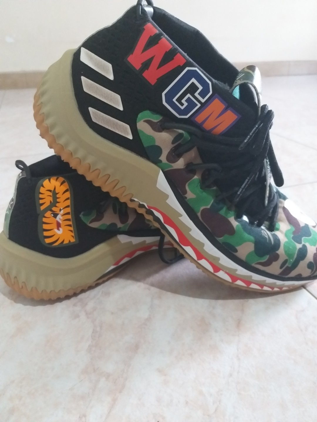 the best attitude f0672 1ba63 Sepatu Adidas x Bape Dame 4 green camo, Mens Fashion, Mens Footwear,  Sneakers on Carousell