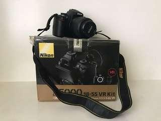 Nikon D5000 with extra lens and tripod
