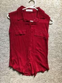 Red sleeveless blouse