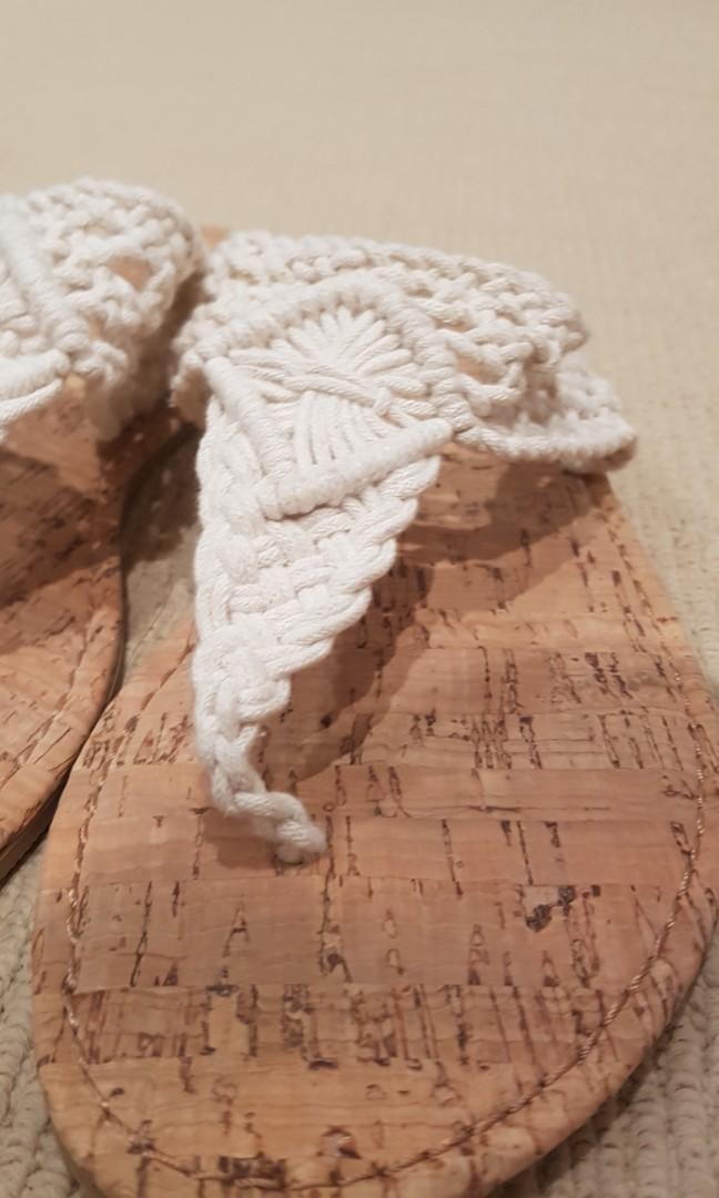 White woven flip flops