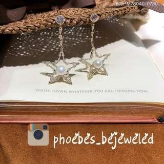 Hypoallergenic star dangling pearl bejeweled earrings