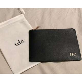 tde. (The Daily Edited) monogram leather clutch