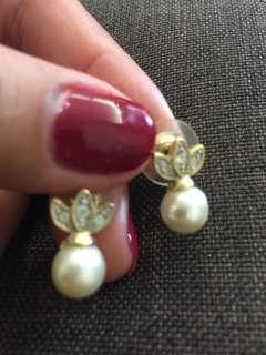 10.) pearl earring