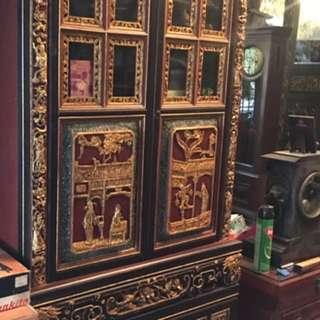 A two tier red and gold cabinet