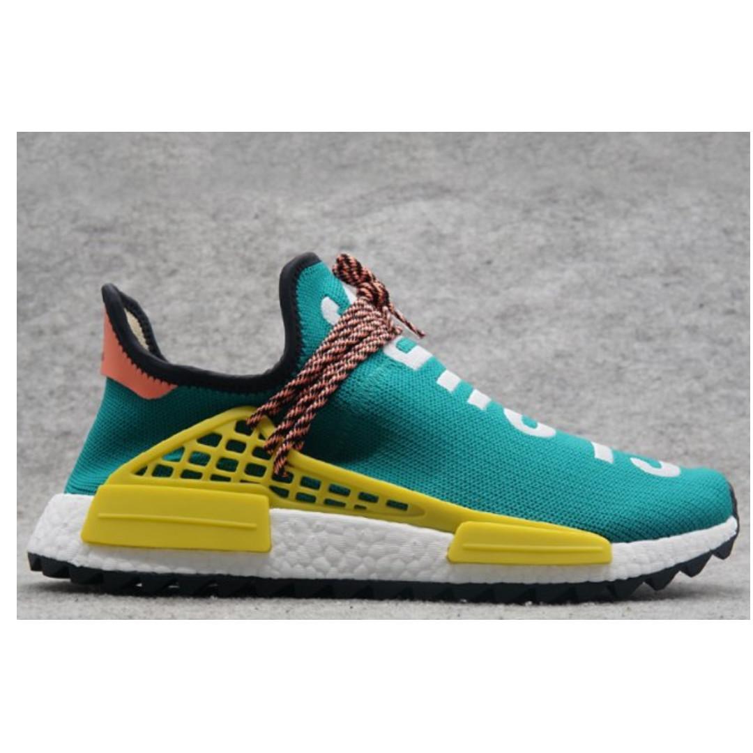 57979ca1adad Pharrell Williams x Adidas NMD HU Trail Sun Glow