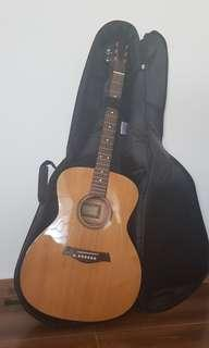 Solid top acoustic guitar with bag & tuner