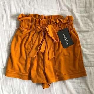 Mustard flowy shorts
