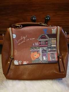New brown faux leather handbag with print
