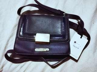 Marla London Navy blue bag.