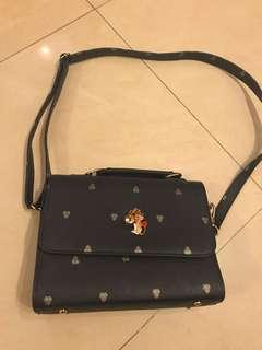 Casual navy bag with cat lock