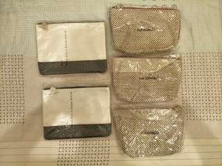全新 sisley 希思黎 化妝包 經典銀色化妝包 手拿包 收納包 萬用包 專櫃化妝包 名牌化妝包 編織 皮紋 藝術感